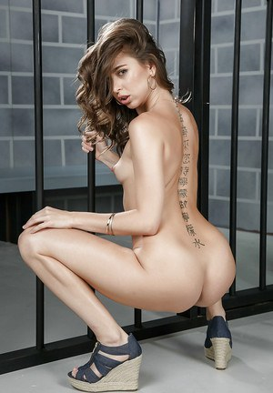 Top pornstar Riley Reid releasing tight ass from skirt in prison cell