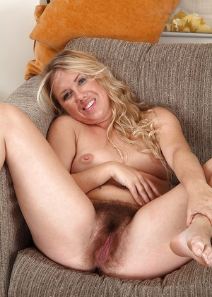 Blonde mom Elle Macqueen doffing dress to display bare legs and hairy cooter