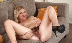 Leggy mom Elle Macqueen sliding panties over nice ass and really hairy vagina