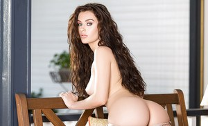 Teen pornstar Lana Rhoades removing dress and lingerie to model naked on bench