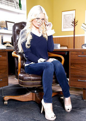 Blonde pornstar Alexis Ford exposing nice tits on office chair