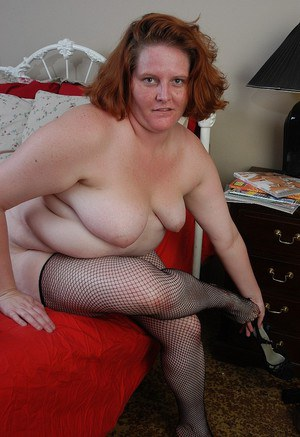 Fat older lady Adrienne strips off lingerie before inserting huge dong in cunt