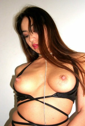 Amateur Asian model Milla flaunting natural tits and erect nipples