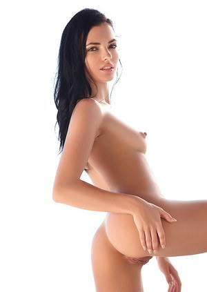 Long-haired brunette Sapphira reveals bubble ass and tiny tits in a hot solo
