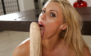 Hot blonde MILF Brittany Bardot teases pussy with fingers and a huge dildo