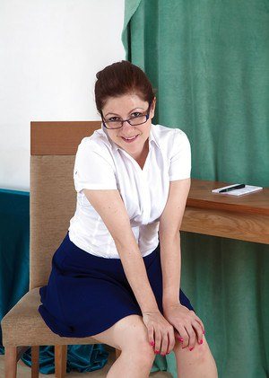 Mature lady Lacey shows that hairy cunt hides beneath her blue skirt