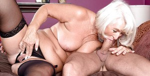 Crazy granny Jeannie Lou goes hardcore and stuffs her mouth with a huge dick