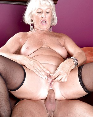Voluptuous granny with saggy tits begs a young dude to fuck her anal