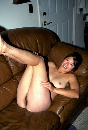 Oriental amateur Amanda unleashing hairy pits and pussy while disrobing