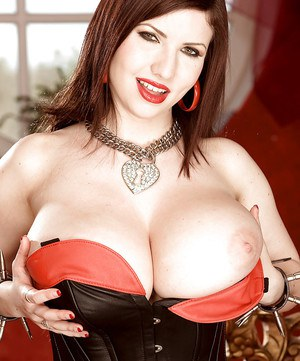 Sexy big tit model Karina Hart letting massive boobs loose from bustier