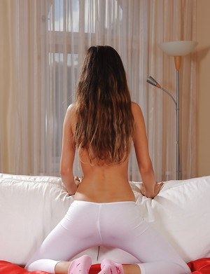 Long-haired tart Nika removes yoga pants and demonstrates juicy clam
