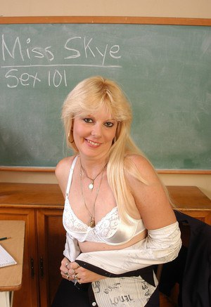 Blonde teacher Skye gets naked in classroom and shows old hairy pussy