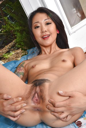 Asian amateur Saya Song shows off tattoos and trimmed bush on blanket outside