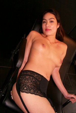 Sultry Asian amateur Milla strutting in garters and black stockings
