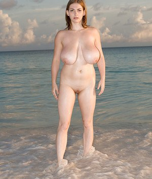 Solo girl Christy Marks unveiling mega tits outside on beach
