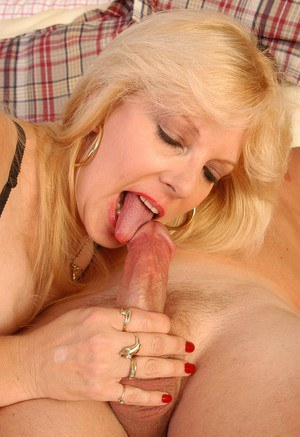 Aged blonde woman Skye having sex with muscled stud in fishnet stockings