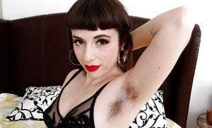 Hairy MILF Simone Delilah peeling off black nylons and lingerie to pose naked