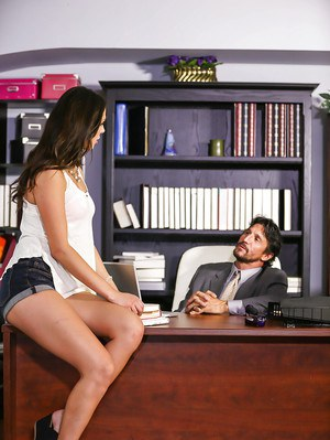 Brunette secretary Anna Morna seducing her boss in denim shorts