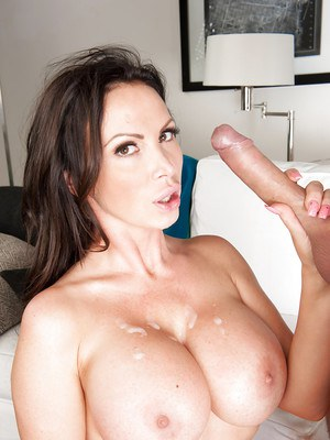 Buxom housewife Nikki Benz giving her man a BJ before sexual intercourse