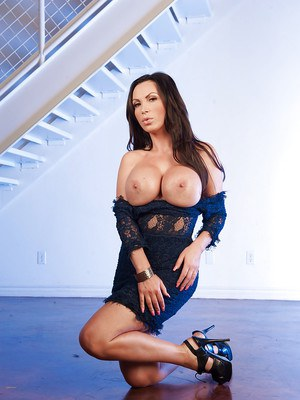 MILF pornstar Nikki Benz showing off huge tits while modeling with firearms