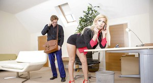 Blonde secretary Candee Licious getting fucked in office wearing red pumps