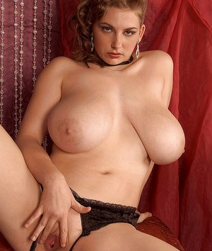 Curvaceous woman in lingerie and corset Christy Marks caresses her huge boobs