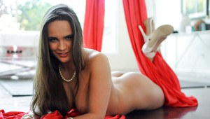 Long-haired babe with piercing Teal Conrad lies on drapes and masturbates