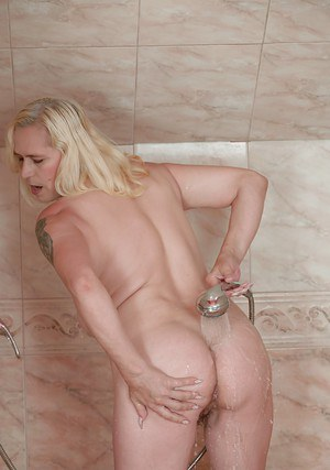 Fair-haired old slut Violett gets in the shower cabin and rinses her cunt