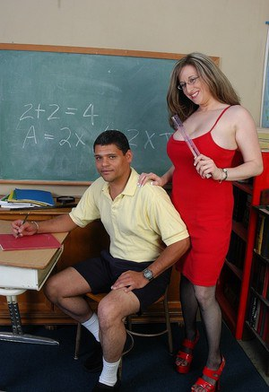 Mature fatty with trimmed cunny Kitty is stretched in the classroom