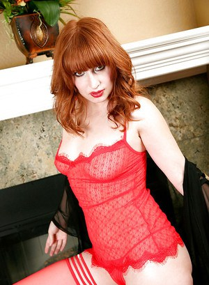 Mature red-haired slut Amber Dawn indulges in self satisfaction