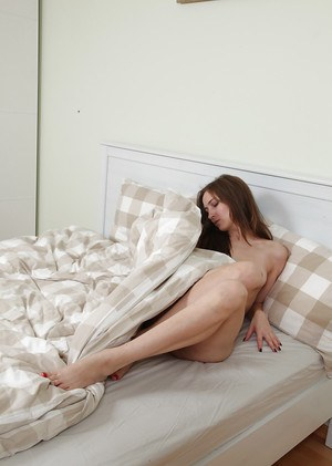 Victoria takes down the panties to pose naked and play with her bush