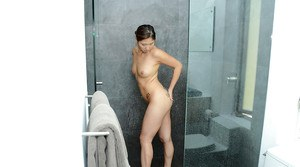 All natural amateur Asian girl Nyomi gets naked in the shower room