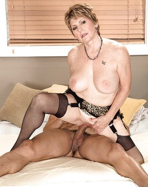 Horny granny Bea Cummins riding big black cock after giving oral sex in nylons