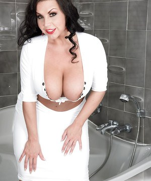 Brunette MILF Sheridan Love letting hooters loose in bathtub for wetting