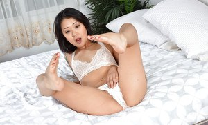 Asian amateur Saya Song parting trimmed muff after sliding lace panties aside