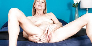 Slender grandma Patsy spreading aged pussy wide open while bending over