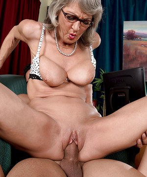 Aged wife Cheyanne having sex with younger lover wearing hosiery and glasses