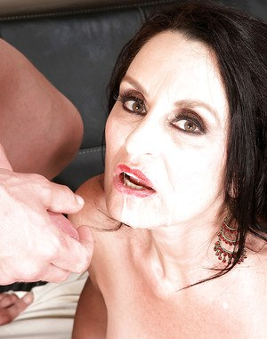 Dark haired granny Rita Daniels sucking younger man's dick before riding him