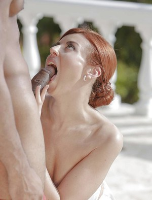 Redhead Euro mom Bianca Resa riding big black cock on lounge chair outdoors