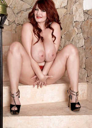 Hot European redhead chick Vanessa exposes saggy tits and fingers hairy twat