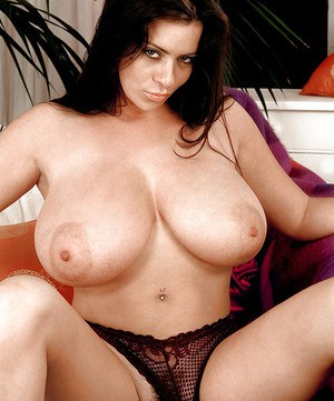 Hot busty MILF Linsey Dawn McKenzie performs a naughty solo and rubs twat hard