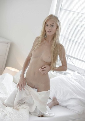 Fancy blonde cutie Nancy takes clothes off exposing tiny tits and skinny body