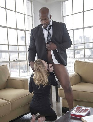 Blonde wife Angel Smalls giving her black husband a blowjob on knees