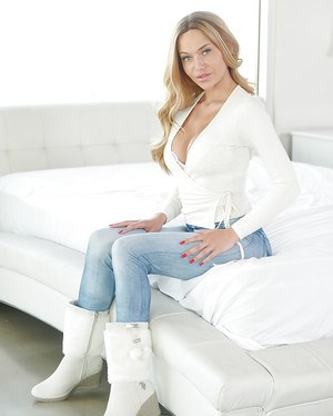 Euro pornstar Subil Arch slowly taking off jeans and boots to model naked