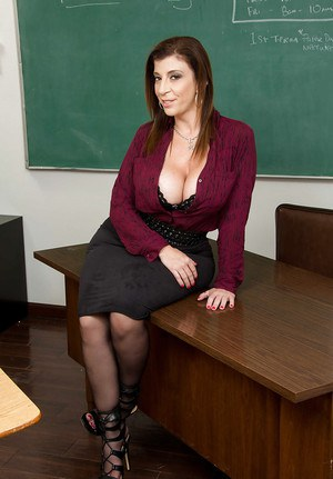 Fully clothed teacher Sara Jay undressing down to nylons and heels on desk