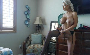 Superb latina MILF Bridgette B posing naked and playing with her big tits