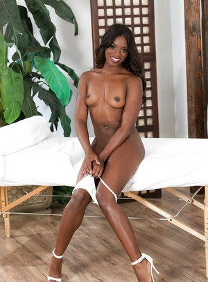 Top black pornstar Ana Foxxx removing white thong on massage table