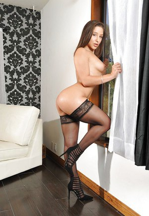 Solo model Abella Danger showing off phat ass while modeling black stockings