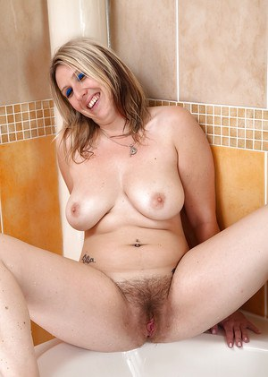 Blonde stunner Mel Harper takes off panties to rub hairy twat in the bathroom