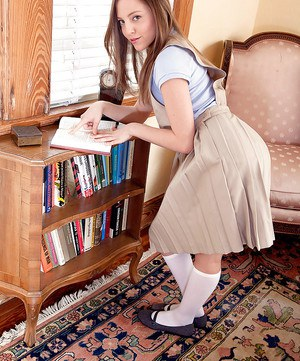 Young schoolgirl Aubrey Star stripping down to white socks in library